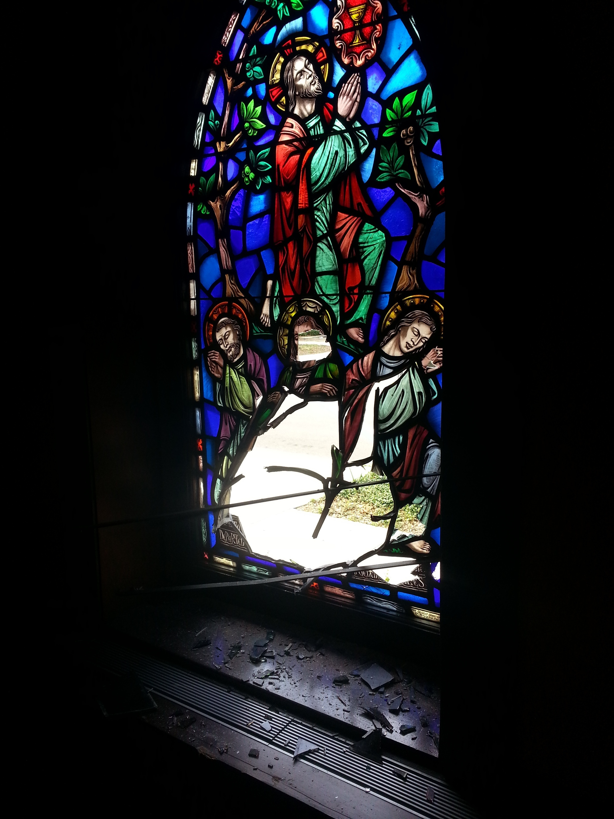 Damage to stained glass window at St Petersburg, Flordia